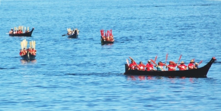 canoes coming in from the Sound